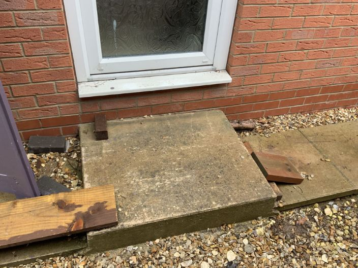 Before image of a flagstone step in DN18