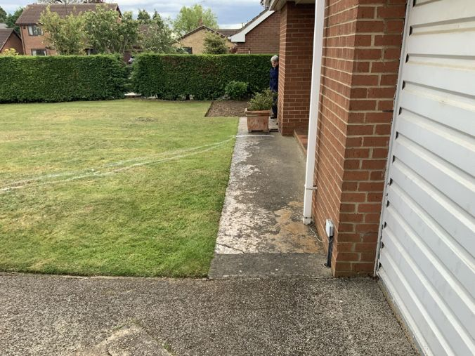 Before image of small pathway and grassed area