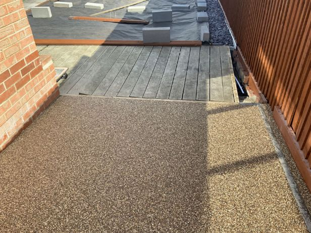 After image of resin driveway up to decking DN18