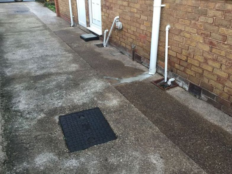 Before image of a side of a driveway in South Elmsall