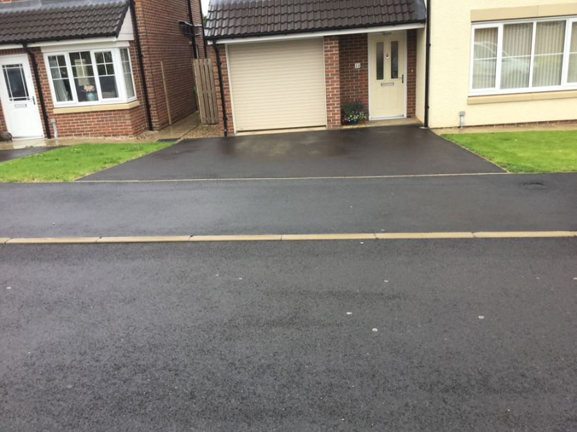 Before image of a tarmac driveway